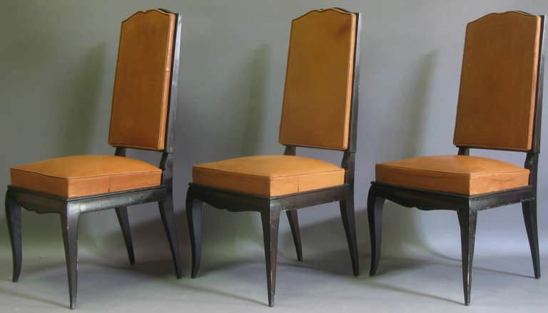Six exquisite French dining chairs from the 1940s era. High backs framed by the wood structure, which taper in very slightly at the top, with