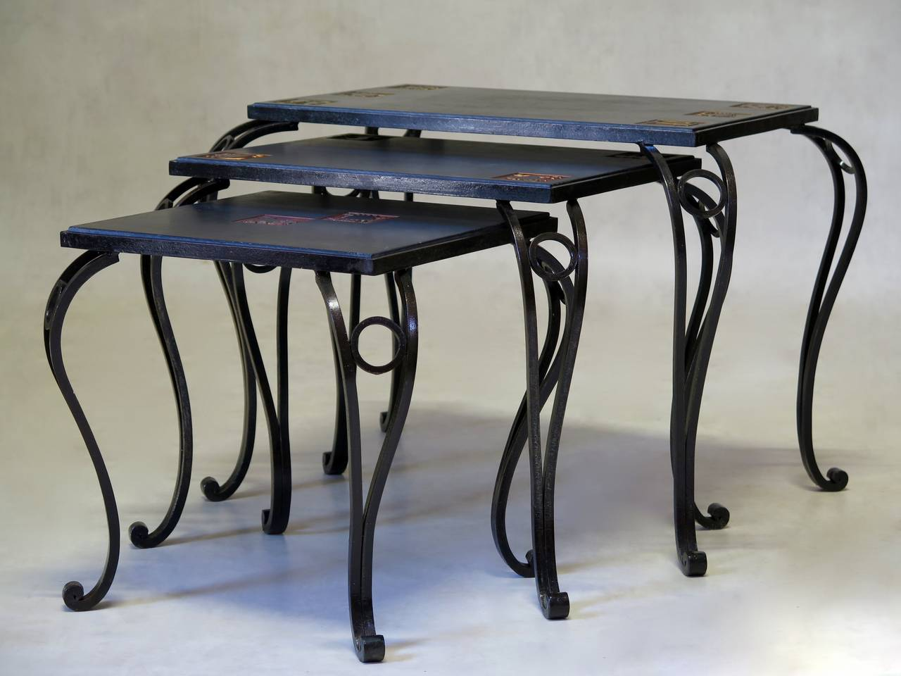 Trio of iron and slate nesting tables with zodiac sign