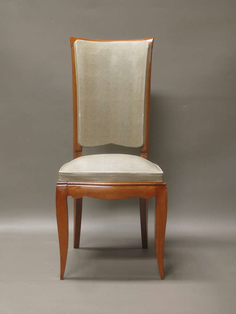 Funky and chic set of eight high-backed dining chairs with shapely and elegant apron and legs. Upholstered in original, good-quality imitation lizard fabric.