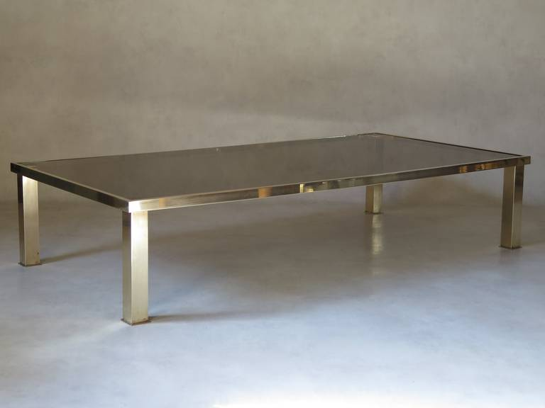 Chic and minimalist rectangular coffee table, with a brass base.  A matching, smaller and square table is also available.