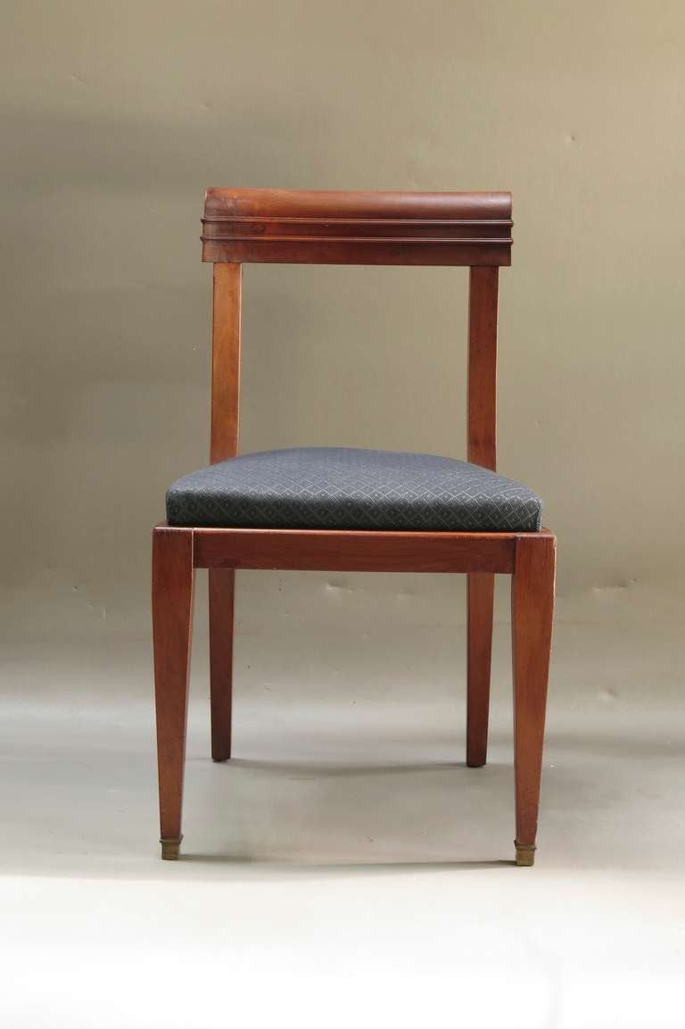 Solid and well made set of six Regency style dining chairs, made of mahogany and upholstered in extremely resilient dark grey horsehair fabric. The seats are wide and comfortable. The front legs end in brass sabots. Elegant and unfussy design.