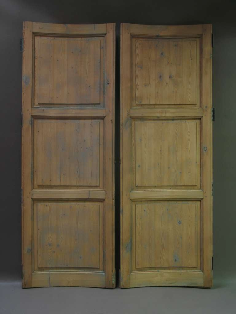Set of six curved pine doors (four identical, plus another very similar pair).