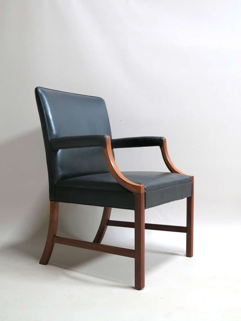 Elegant and sophisticated pair of large mahogany armchairs by Ole Wanscher, inspired by the Gainsborough chair.  Upholstered in black leather.