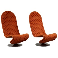 "A pair of tall back ""System 1-2-3"" Lounge chairs"