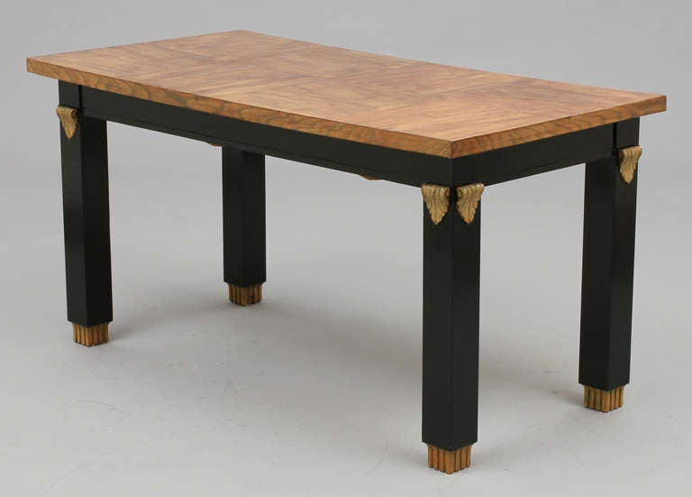 The library table attributed to Otto Schulz, Sweden, circa 1940. Lacquered and painted wood. Measures: L 60