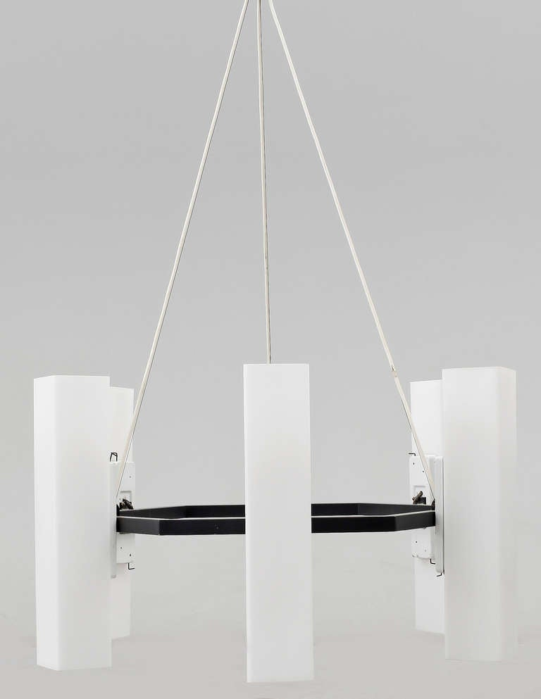 """A chandelier designed in early 1960th by Swedish Architect Jan Wahlman (son of Architect Lars Israel Wahlman) for Dandery Municipal Building. Later production. Grey coated metal frame with opal glass shades. Diam. 34""""; Measures: Each shade"""