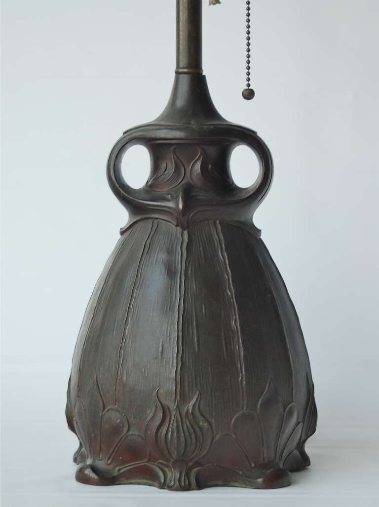 """Table lamp in Art Nouveau style by Pittsburgh Brass and Glass Company, informally known as the """"owl lamp"""", circa 1930. Patinated cast metal. Existing wiring, rewiring available upon request."""
