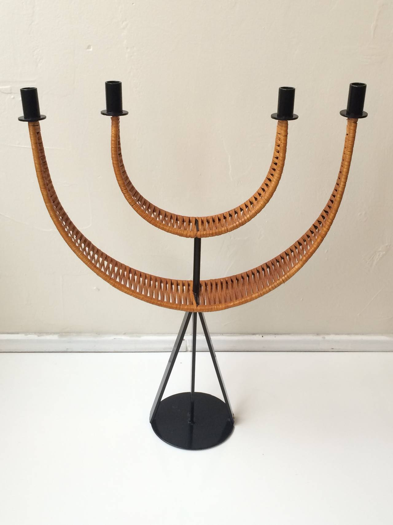 Stunnig candelabra designed by Arthur Umanoff wrapped in woven cane. Newly powder-coated and re-caned.