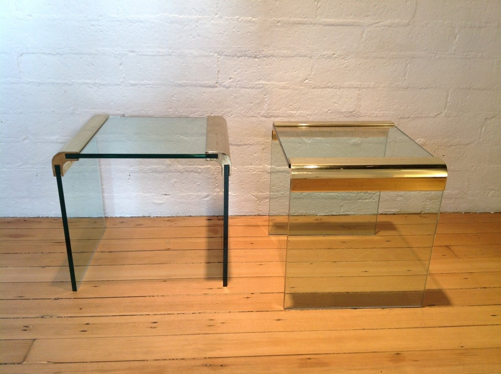 A pair of glass & brass side tables by Pace Collection.