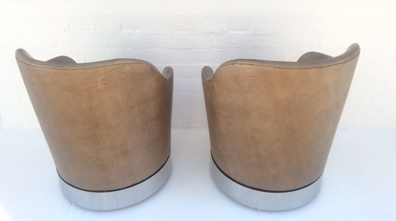 Polished Swivel Lounge Chairs Designed by Phillip Enfield For Sale