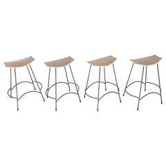 Set of Four Wicker and Painted Steel Stools Designed by Arthur Umanoff
