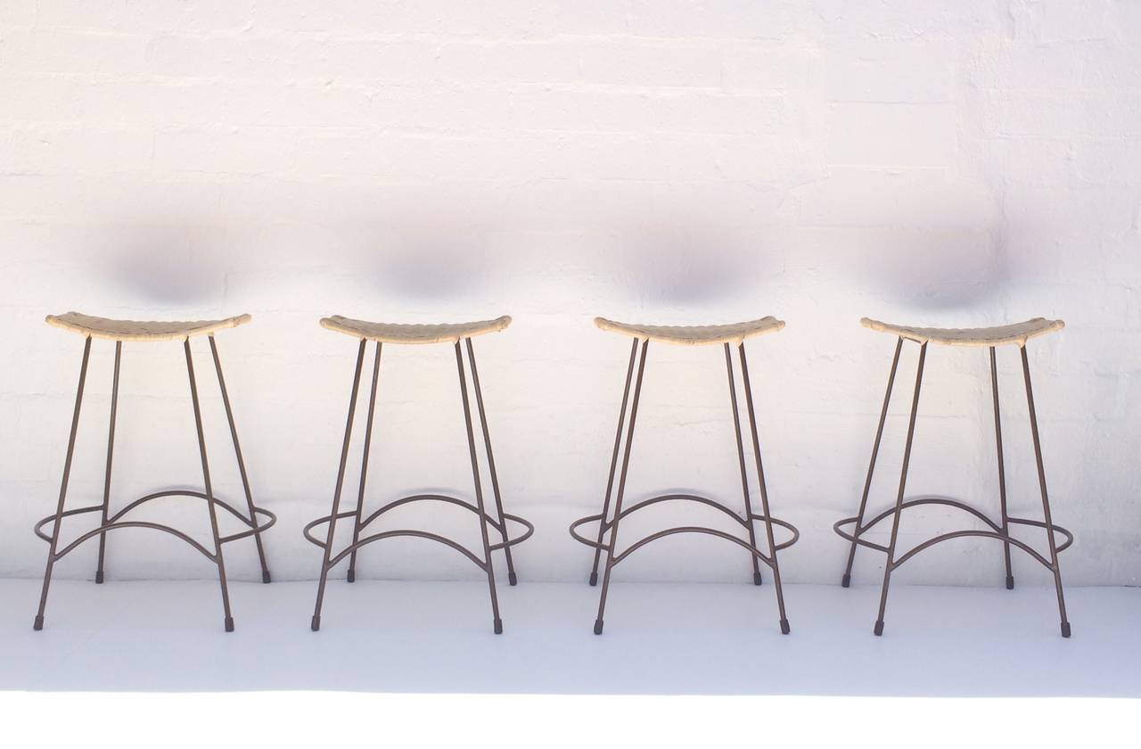 Set Of Four Wicker And Painted Steel Stools Designed By