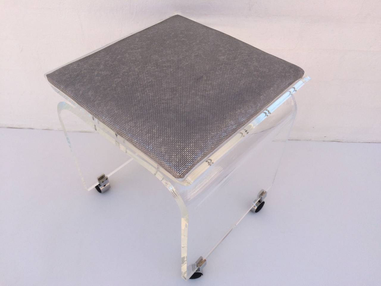 """Waterfall"" Acrylic Vanity Stool on Wheels Designed by"