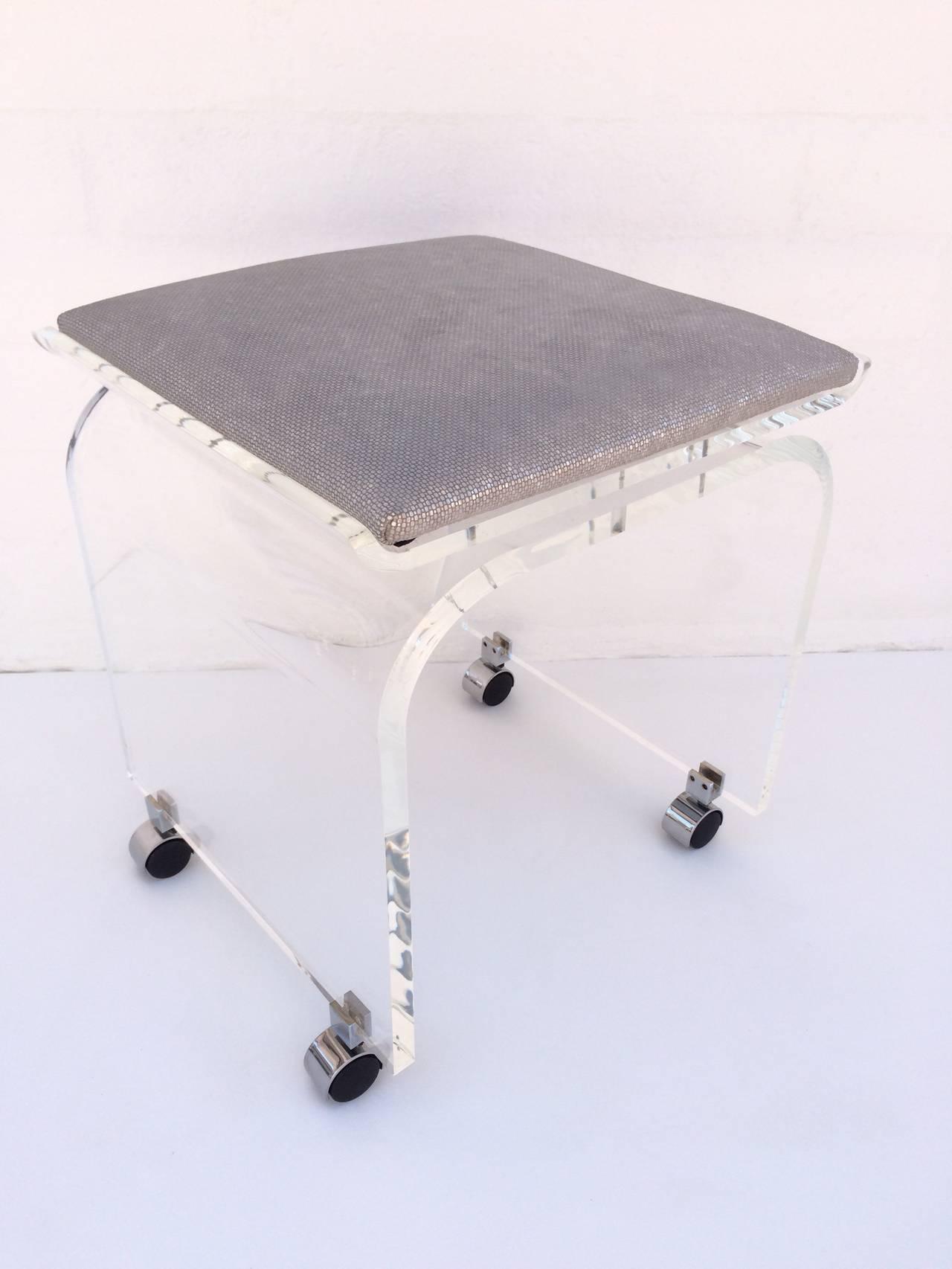 waterfall acrylic vanity stool on wheels designed by charles hollis