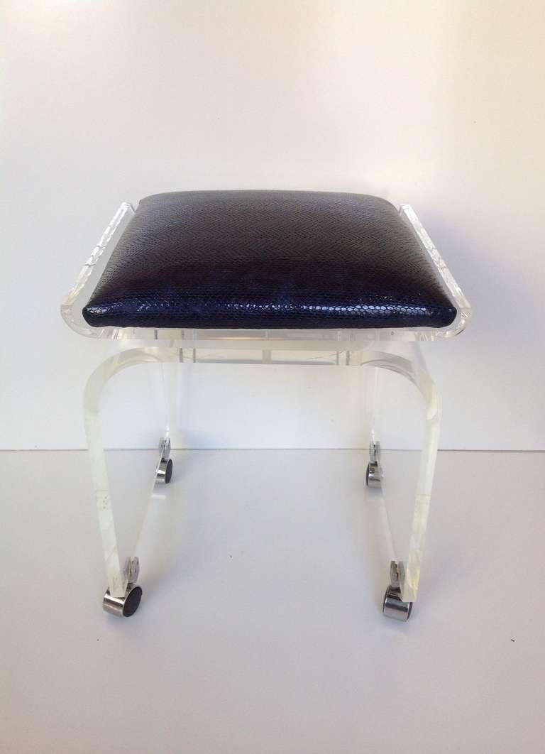 acrylic swivel top vanity stool designed by charles hollis