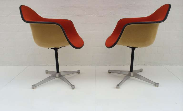 A Pair Of Bucket Swivel Chairs Designed By Charles Eames For Herman Miller.  These Chairs