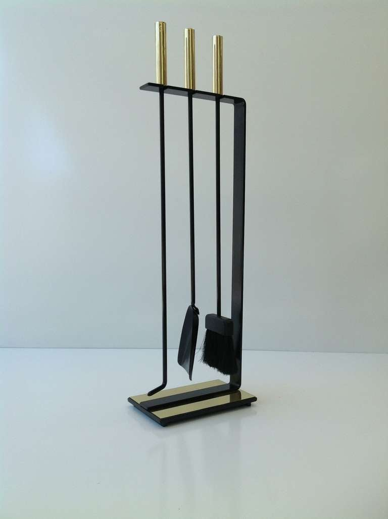 polished brass and black iron fireplace tool set made by pilgrim