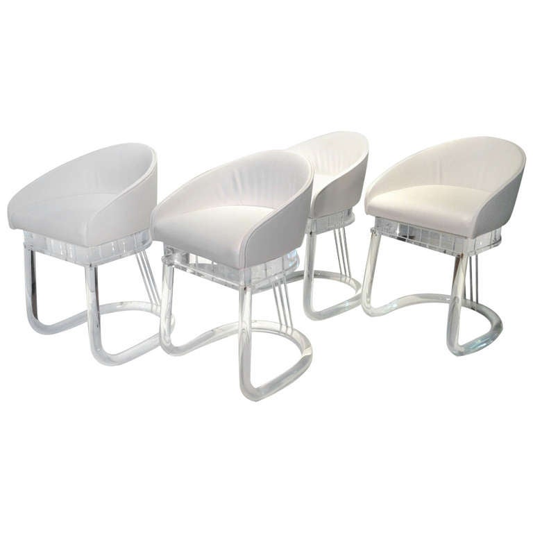 Set of four Lion in Frost Acrylic Dining Chairs