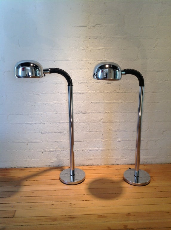 A pair of chrome floor lamps that flex at the top to adjust the light. The Periscopio light was designed  by Danilo & Corrado Aroldi in 1966. The floor light was produced by Stilnovo in 1972.