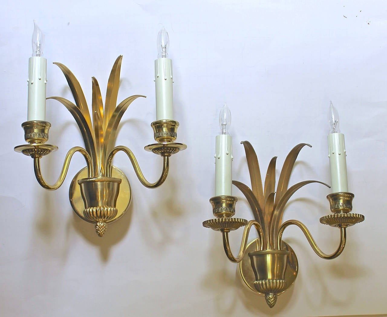 Elegant pair of wheat motif brass 2 light wall sconces, manufactured by S.A. Boulanger, Belgium circa 1980. Each uses 2 40-watt candelabra base bulb, newly wired for US.  This item is located at our Dallas showroom.