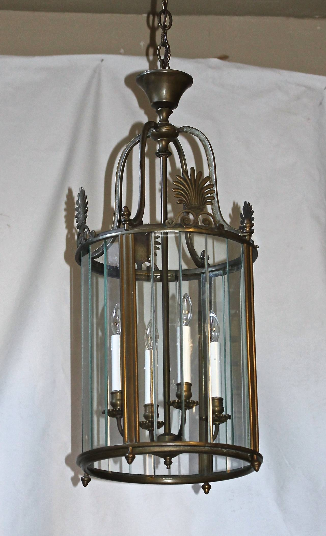 "Large Italian Neoclassic heavy solid bronze or brass hall or entry lantern with segmented glass panels and four lights. Uses 4 - 40 watt candelabra base bulbs, newly wired. Fixture size 14"" D x 30"" T, overall height including chain"