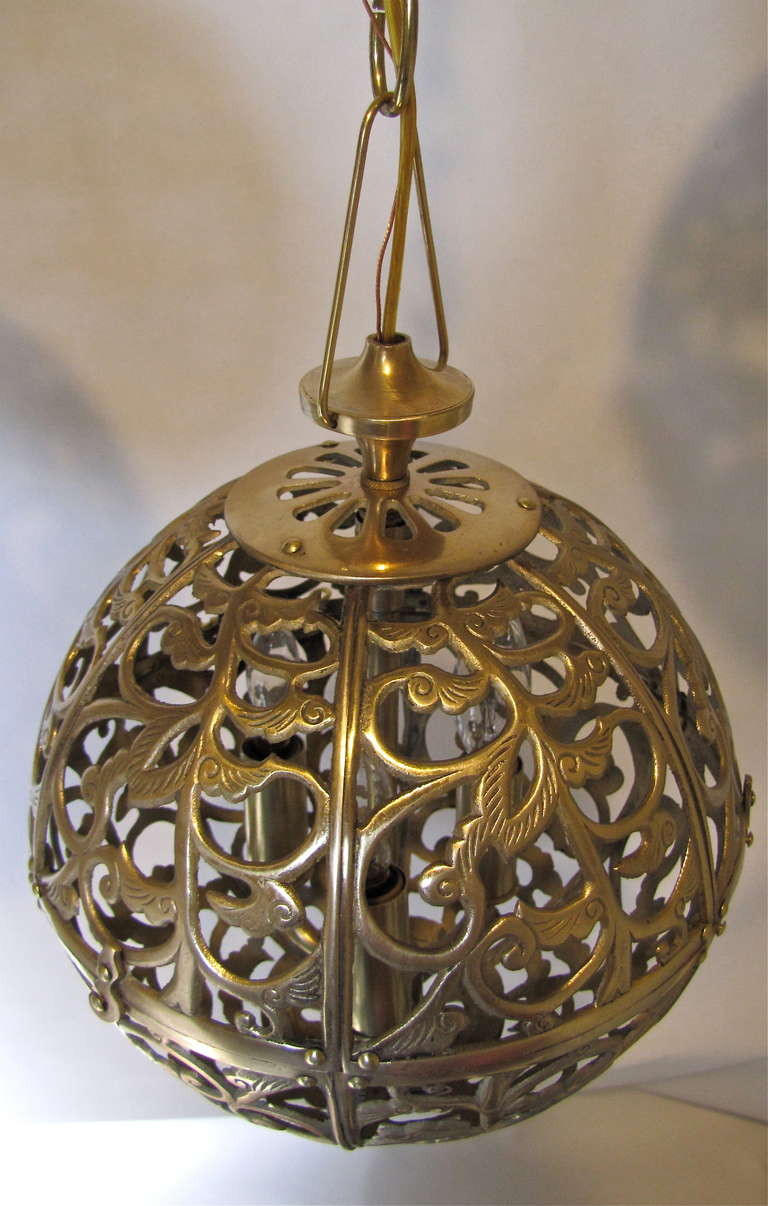 Mid-20th Century Trio Pierced Brass Asian Mid Size Ceiling Pendants For Sale