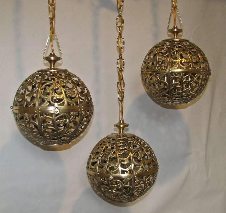 Trio Pierced Brass Asian Mid Size Ceiling Pendants In Excellent Condition For Sale In Palm Springs, CA