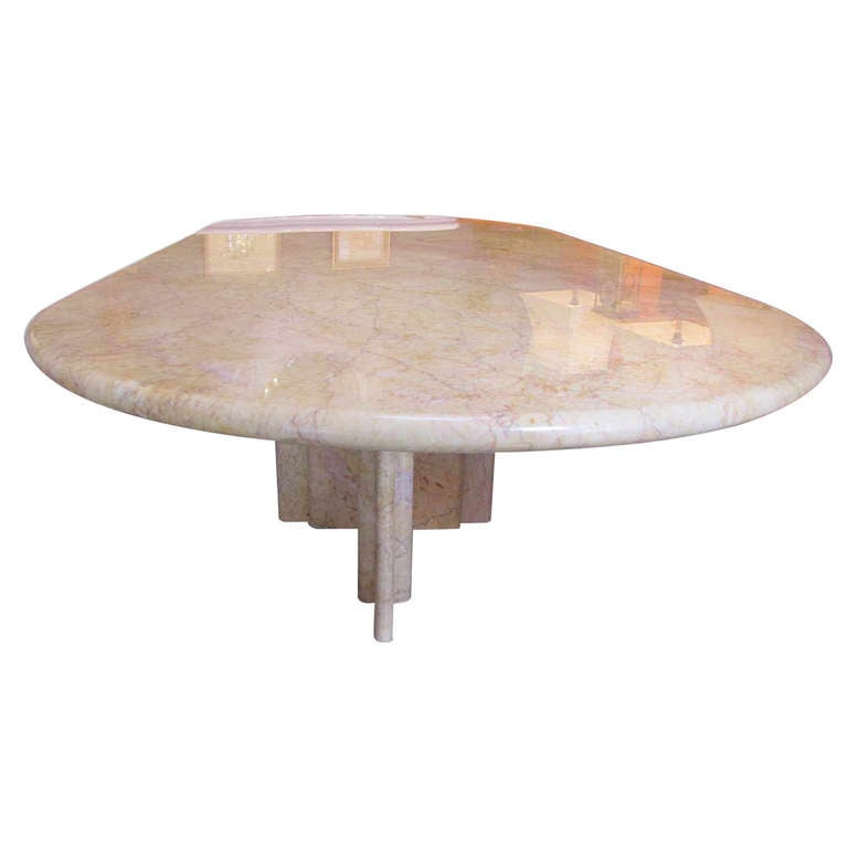 Sculptural Rosso marble table by Gae Aulenti