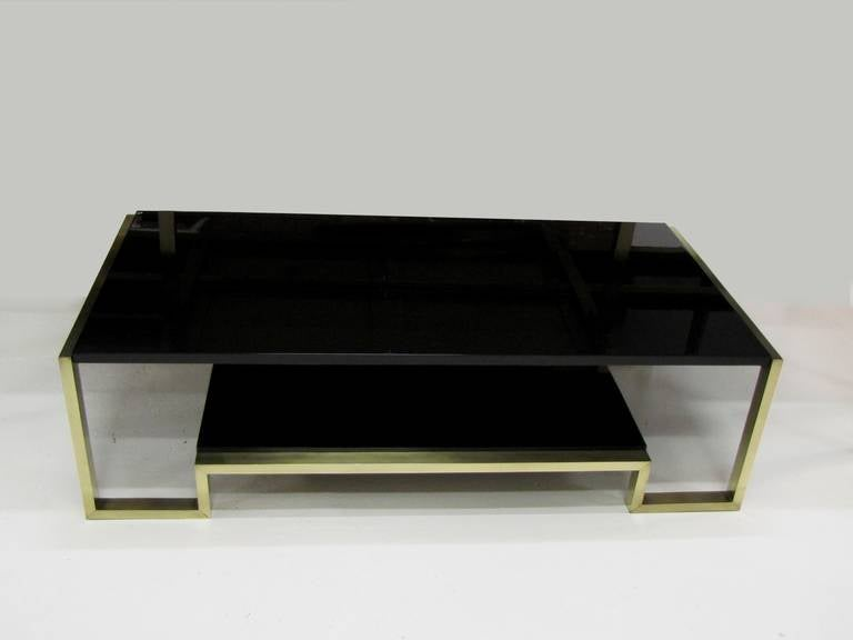 Very Elegant 1970s Coffee Table, In Polished Brass And Black Lacquered  Wood. In The