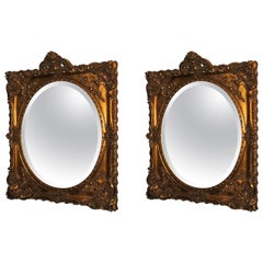 Elegant Pair of Antique Oval Bevelled Regal Mirrors in Carved Giltwood Frame