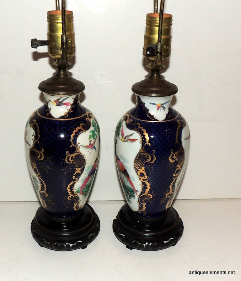 Porcelain Wonderful Pair of Chinoiserie Blue, Hand-Painted Lamps Depicting Birds For Sale