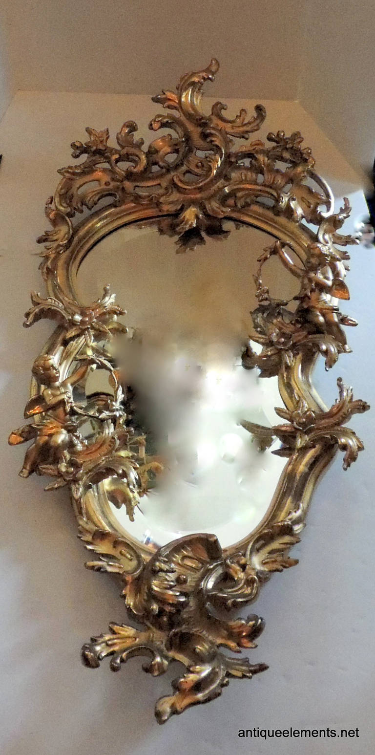 Extraordinary 19th century french carved and gilt cherub for Floor mirror italian baroque rococo style