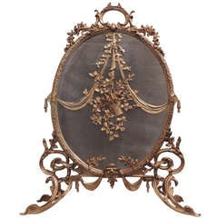 An Exquisite French Ormolu Mounted Oval Dore Bronze Fire Place Screen
