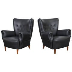 Pair of Black Leather Tufted Danish 1950s Lounge Chairs