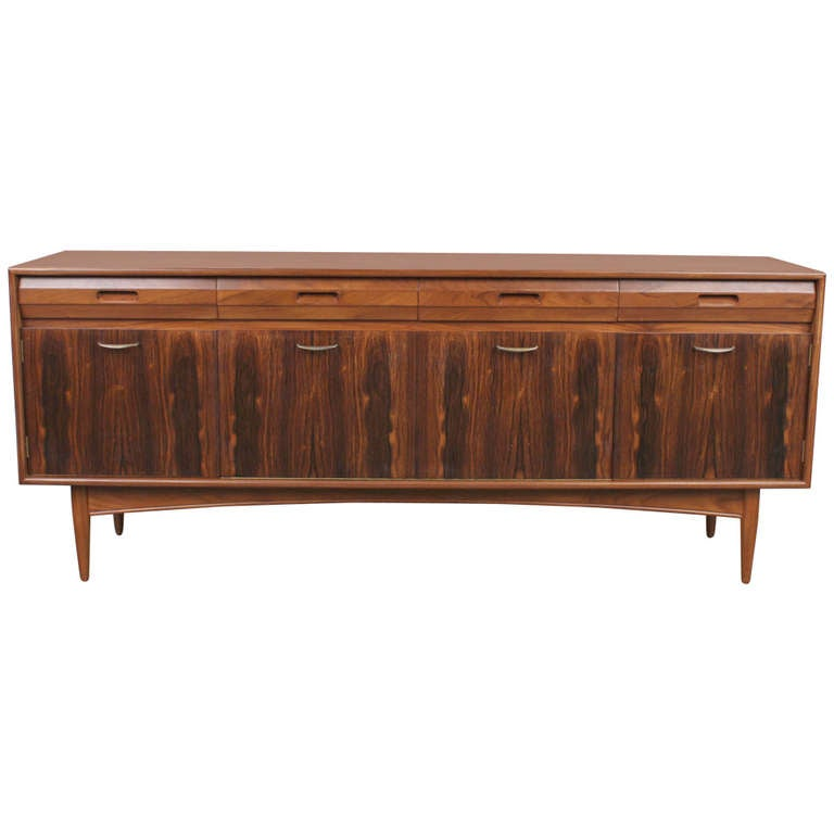 this rosewood and mahogany mid century modern low sideboard is no