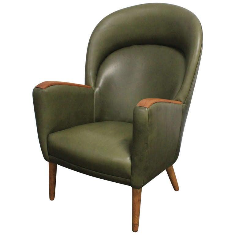 Danish leather mid century modern lounge chair with teak