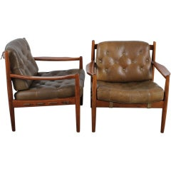 Pair of Mid Century Modern tufted leather chairs.