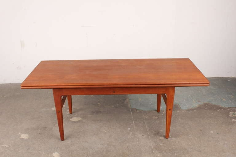 This Mid Century Teak Coffee Table Morphs From A Into Dining Surface