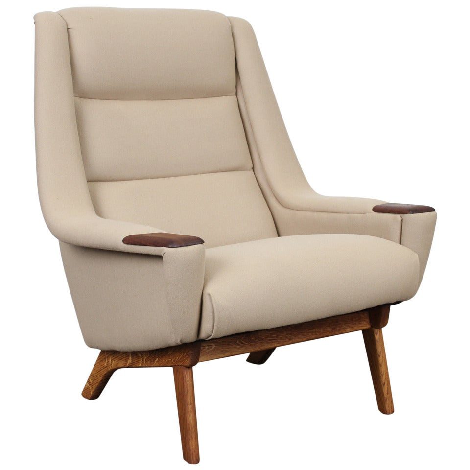 this danish mid century modern tall lounge chair with teak arm accents