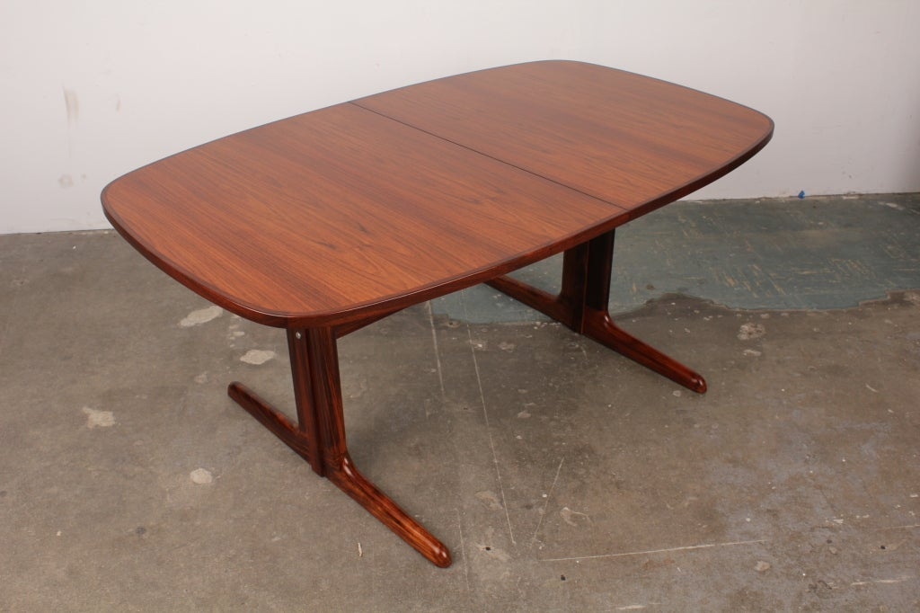 Danish mid century modern rosewood pedestal oval dining table at