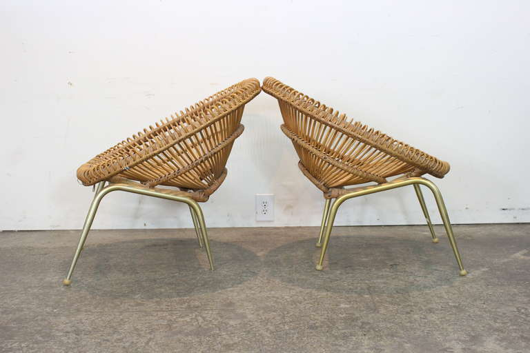 Beautiful pair of rattan chairs in the style of Franco Albini.