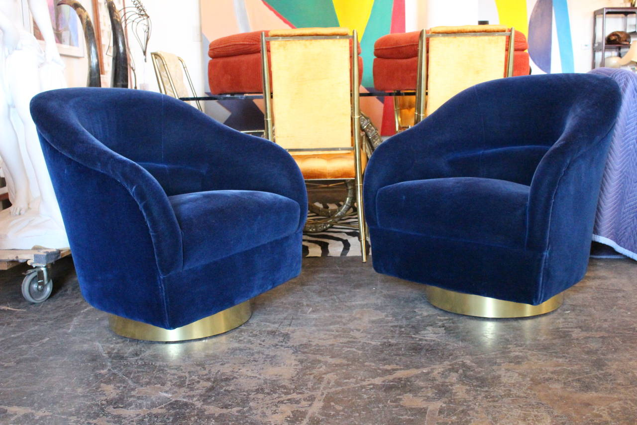 Pair Of Blue Mohair Swivel Chairs With Brass Plinth By Ward Bennett.