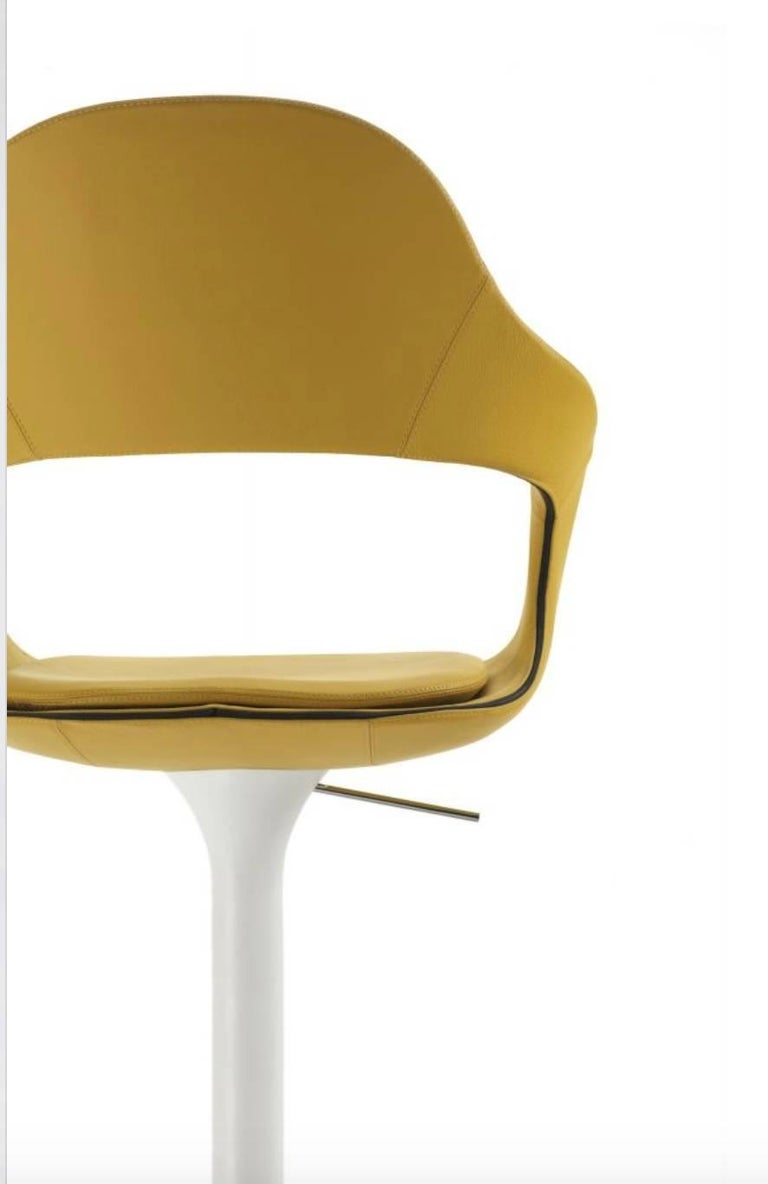Modern Italian bar stool, handmade in Italy, adjustable height and swivel seat, available in full grain soft leather in many different color or available in felt. This stool features a high or low back (your choice please refer to pictures) with a