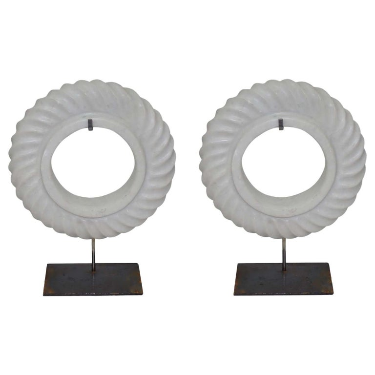 Contemporary Chinese pair of thick white stone in a decorative rope twist design on steel Stand. Also available in black. Stand measures 6