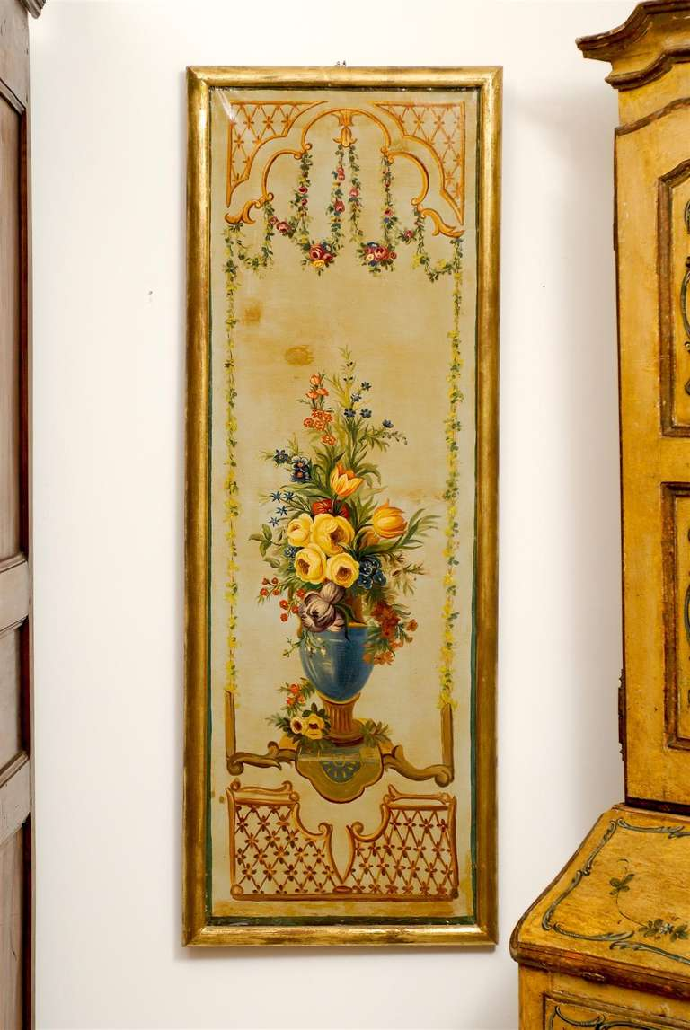 A pair of French Napoleon III period painted decorative panels with floral motifs from the mid-19th century, set inside giltwood frames. Each of this pair of decorative panels features an exquisite décor made of colorful bouquets displayed in green