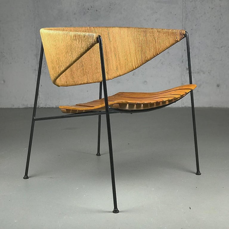 An exceptional example of museum-quality American modern design; 1950s lounge chair by Arthur Umanoff, manufactured by Shaver Howard and distributed Raymor. Made of iron, paper-cord and wood.