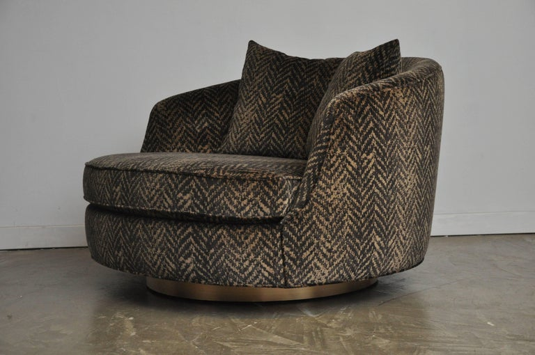Large cuddle chair by Milo Baughman. Fully restored and reupholstered. Black and gold printed velvet upholstery on bronze swivel base.