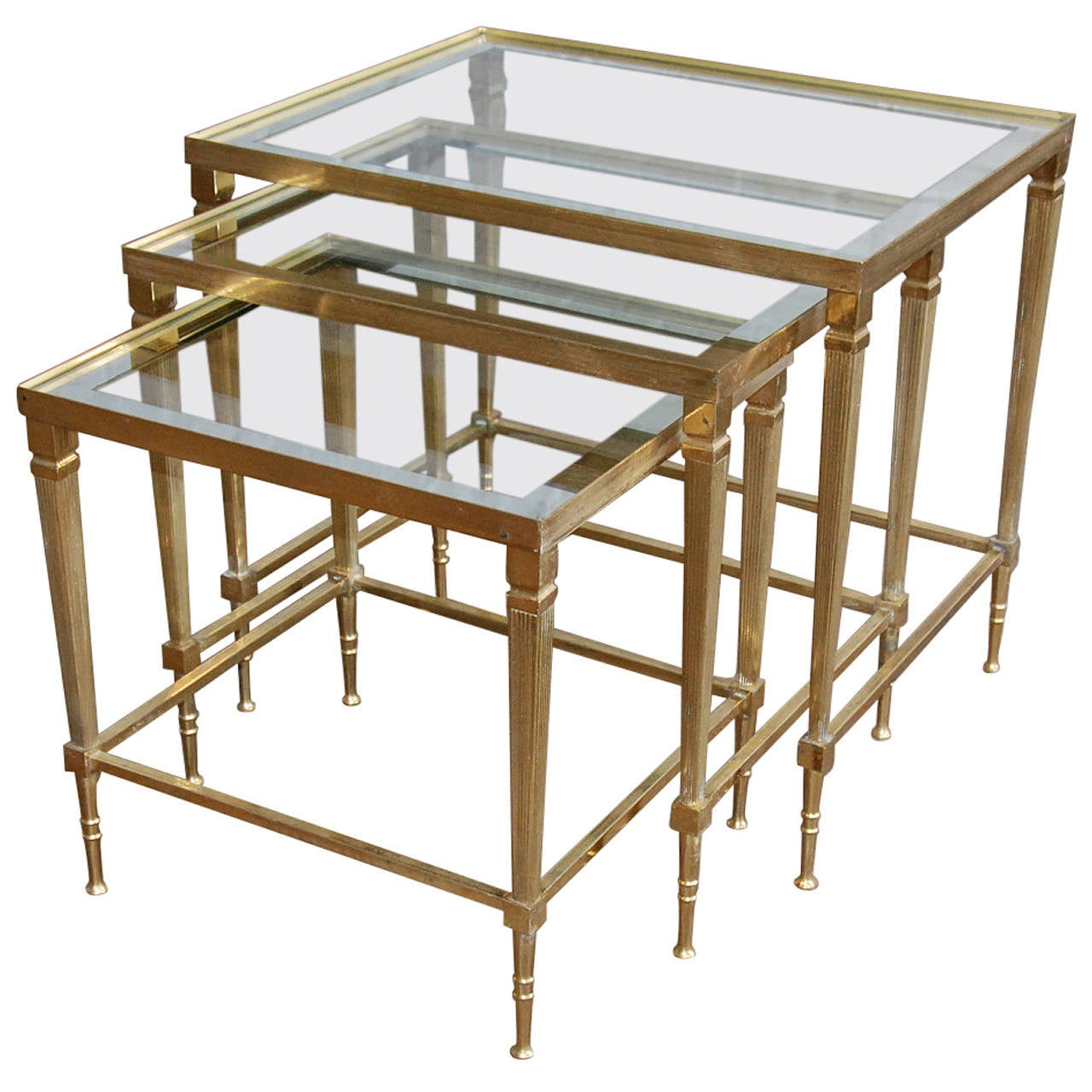 Italian brass and mirrored glass trio of nesting tables