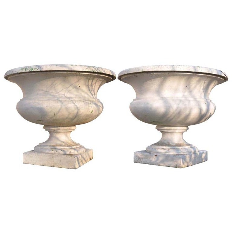 Pair of important cast iron garden vases dated 19th C. For Sale