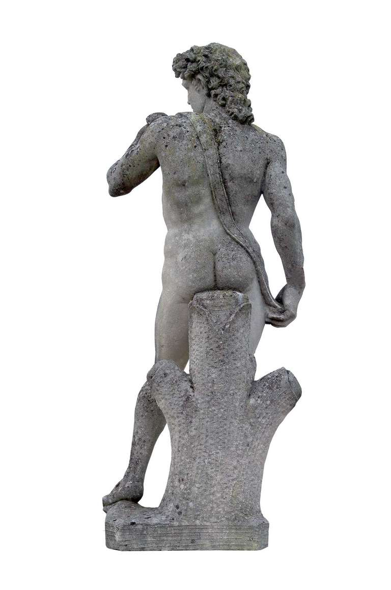 After Michelangelo: a carved stone figure of David, circa 1960. Base: 53 x 51 in. # E3697.